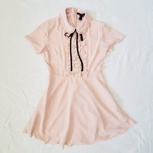 Vintage inspired pink dress with black ribbon